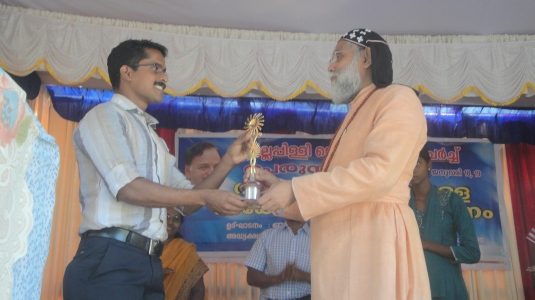 Aravindakshan coach of Rugma honoreed2