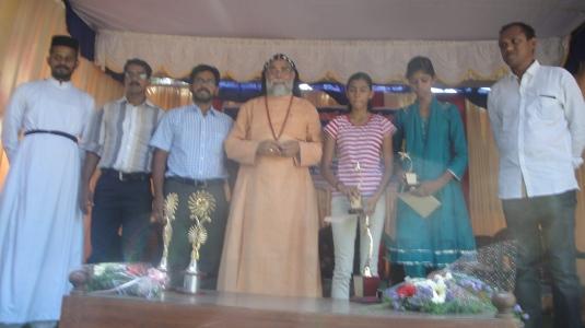 Scholarship winners with HG and vicar Fr Joseph Chamavila1